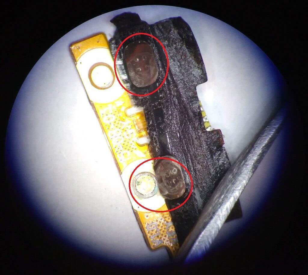 боковые кнопки смартфона BQS 5065 под микроскопом